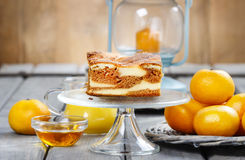 Piece of toffee and vanilla cake on transparent glass cake stand Royalty Free Stock Images