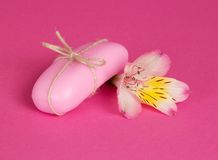 Piece of toilet soap and the flowers Stock Photo