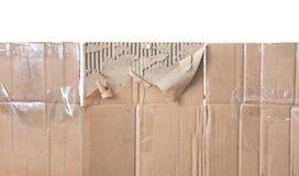 Piece of torn cardboard Stock Photo