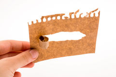 Piece of torn paper in hand Stock Photos