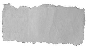 Torn paper on white. Piece of torn paper on plain background Royalty Free Stock Photos