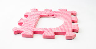 Piece of a toy puzzle - The letter D Royalty Free Stock Photography