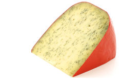 Piece of traditional frisian cheese with herbs Stock Photo