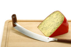 Piece of traditional frisian cheese with herbs Royalty Free Stock Photos