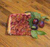 A piece of traditional German pie made from fresh plums. stock photo