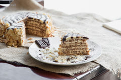 Piece of a traditional Hungarian Esterhazy cake on the plate Royalty Free Stock Photo