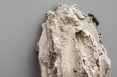 Piece of travertine rock isolated. Over grey background. Sedimentary rock coming from Malaga mountains, Spain stock image