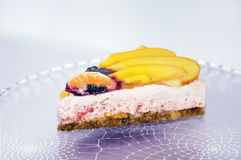 Piece of an unbaked fruit cake with cream Royalty Free Stock Photo