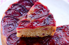 Piece of Upside down plum cake. Upside down plum cake on a serving plate Stock Photography