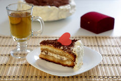 Piece of Valentine`s Day cake with cup of tea Stock Image