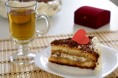 Piece of Valentine`s Day cake with cup of tea Stock Photo