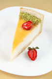 Piece of Vanilla Cheesecake with strawberries Royalty Free Stock Photos