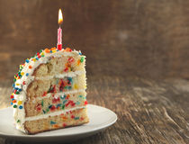 Piece of Vanilla Sprinkles Cake Stock Photography