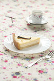 Piece of Vanilla Tart on a white plate Royalty Free Stock Photography