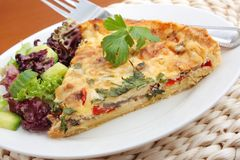 A piece of vegetable quiche Stock Photo