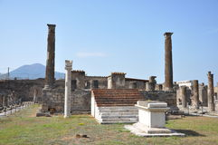 A piece of Vesuvius seen between the columns of Pompeii. Stock Image