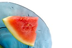 Piece of watermelon. On blue glass plate Royalty Free Stock Photography