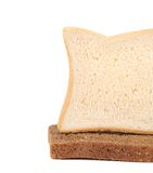 Piece of white and black bread. Stock Photography