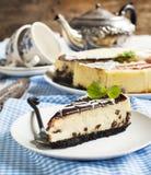 Piece of white and dark chocolate cheesecake Stock Image