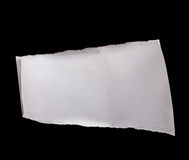 Piece of white paper isolated on black Royalty Free Stock Image