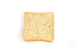 Piece of whole wheat bread i Stock Images