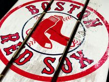 Boston Red Sox Fence. A piece of wood fence with the emblem of the Boston Red Sox Stock Image