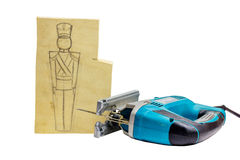 Piece of wood with a pencil drawing of a soldier and jigsaw. Soldiers will be sawed jigsaw Royalty Free Stock Photography