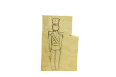 Piece of wood with a pencil drawing of a soldier. Soldiers will be sawed jigsaw Stock Photos
