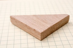 Piece of wood in the shpae of triangle Royalty Free Stock Images