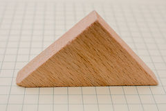 Piece of wood in the shpae of triangle Royalty Free Stock Image