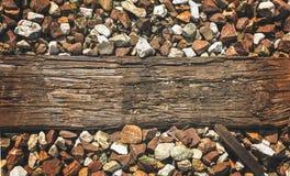 Piece of wood on train tracks stock photo