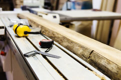 Piece of wood in the woodworking machines stock photo