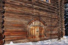 Piece of wooden log farmhouse. With round door Stock Photos