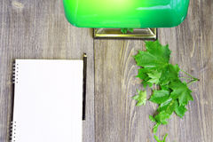 A piece of work space with paper, pencil. green lamp and maple leaves Royalty Free Stock Image