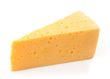 Piece of yellow cheese Stock Images