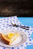 Piece of Yellow lemon pie. Yellow lemon pie on a blue table stock photography