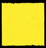 Piece of yellow paper. Isolatd on black, edges are frayed Stock Images