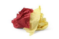 Piece of yellow and red toilet paper Royalty Free Stock Image