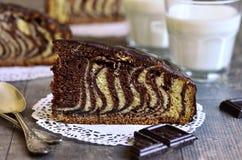 Piece of ''Zebra'' cake. Royalty Free Stock Photo