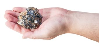 Piece of zinc and lead mineral ore on male palm Royalty Free Stock Image
