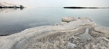 Piecefull Dead sea shore. Peaceful Dead sea shore with hotels view at horizon Royalty Free Stock Photos