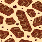 Pieces of aerated chocolate on a beidge background. Seamless pattern, porous Royalty Free Stock Images