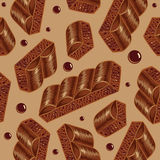 Pieces of aerated chocolate on a beige background Royalty Free Stock Photo