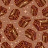 Pieces of aerated chocolate on a brown background Stock Photography