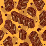 Pieces of aerated chocolate on a orange background Stock Photography