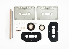 Pieces of Analogue Cassette on White Background. Magnetic tape cassette design waiting to be repaired royalty free stock photography