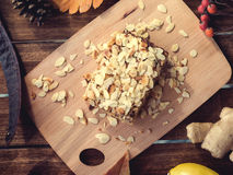Pieces of apple pie decorated on wooden table Stock Photo