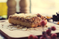 Pieces of apple pie decorated on wooden table Stock Photography