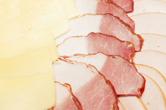Pieces of bacon and cheese Stock Images