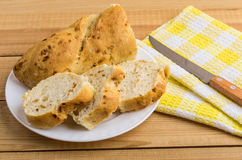 Pieces of baguette in glass plate and knife on napkin Stock Photo